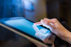 Woman holding digital tablet, closeup Royalty Free Stock Image
