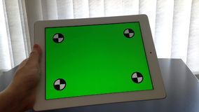 Woman holding digital tablet with a green screen stock footage