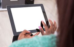 Woman holding digital tablet at home Royalty Free Stock Photography