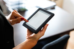 Woman holding a digital tablet Stock Image