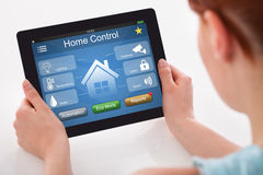 Woman Holding Digital Tablet With Remote Home Control System Royalty Free Stock Photography