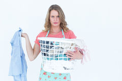 Woman holding dirty clothes Stock Photo