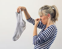 Woman holding dirty socks Stock Photos