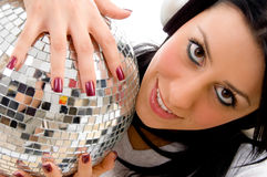 Woman holding disco mirror ball Stock Photo