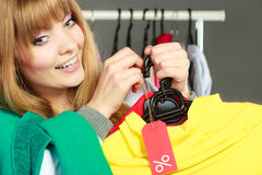 Woman holding discount label. Sale and retail. Stock Image
