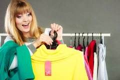 Woman holding discount label. Sale and retail. Stock Photos