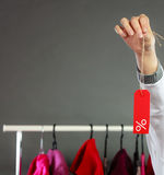 Woman holding discount label. Sale and retail. Royalty Free Stock Image
