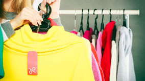 Woman holding discount label. Sale and retail. Royalty Free Stock Images