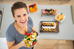 Woman holding dish with halloween trick or treat candy Stock Photography