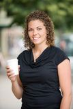 Woman Holding Disposable Coffee Cup Outdoors Royalty Free Stock Photo