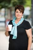 Woman Holding Disposable Coffee Cup Outdoors Stock Photo