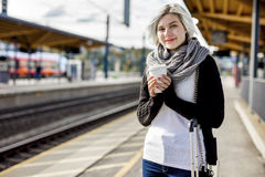 Woman Holding Disposable Coffee Cup At Train Station Royalty Free Stock Photo