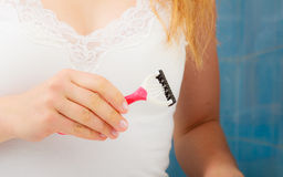 Woman holding disposable pink razor blade Royalty Free Stock Images