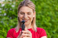Woman holding DJI Osmo Camera stock photo