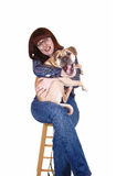 Woman holding dog. Stock Images