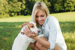 Woman holding dog in the arms Royalty Free Stock Images