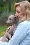 Woman holding dog, Italian Greyhound Royalty Free Stock Photography