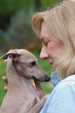 Woman holding dog, Italian Greyhound Royalty Free Stock Images