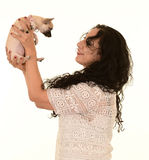 Woman holding dog. A smiling woman holding a cute small dog Royalty Free Stock Images