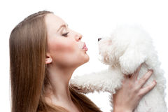 Woman holding dog Royalty Free Stock Photos