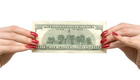 Woman holding dollar. Front view on white Royalty Free Stock Photography