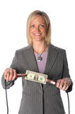 Woman Holding Dollar Bill with Jumper Cables. Businesswoman holding dollar bill with jumper cables Stock Image