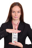 Woman holding a 100 dollar bill Royalty Free Stock Photo