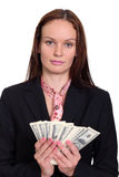 woman holding a 100 dollar bill Stock Photo