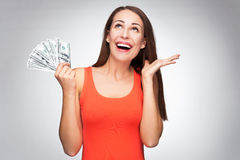 Woman holding dollar bills Royalty Free Stock Photography