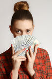 Woman holding dollar bills Stock Photo