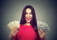 Woman holding dollar and euro banknotes Royalty Free Stock Image