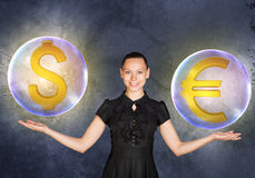 Woman holding dollar and euro signs in bubbles Royalty Free Stock Image