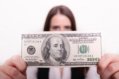 Woman holding dollar in front of her face. Royalty Free Stock Photo