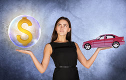Woman holding dollar sign in bubble and car. Busineswoman holding dollar sign in big bubble and caron grey background Royalty Free Stock Images