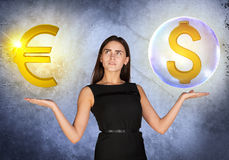 Woman holding dollar sign in bubble and euro. Busineswoman holding dollar sign in big bubble and euro sign on grey background Stock Photos