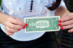 Woman holding dollar upside Stock Image