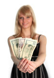 Woman holding Dollars. To the camera Royalty Free Stock Image