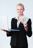 Woman holding dollars and a laptop Royalty Free Stock Images