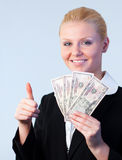 Woman holding dollars with thumb up Stock Photos