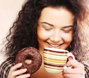 Woman holding donut and coffee Royalty Free Stock Photography