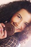 Woman holding a donut. Young beautiful woman holding a donut Stock Photos