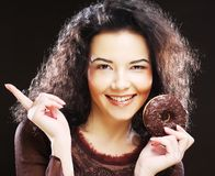 Woman holding a donut. Young beautiful woman holding a donut Stock Images