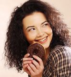 Woman holding a donut. Young beautiful woman holding a donut Stock Photography