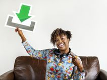 Woman holding a download sign royalty free stock photo
