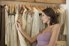 Woman Holding Dress Stock Images