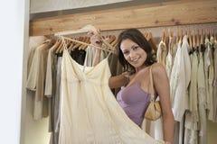 Woman Holding Dress Stock Image