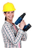 Woman holding a drill Royalty Free Stock Photo
