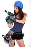 Woman holding drill Royalty Free Stock Photo