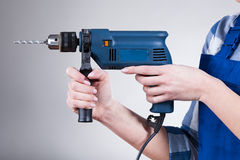Woman holding a drill Royalty Free Stock Photography