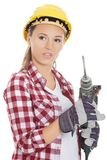 Woman holding drill Stock Photo
